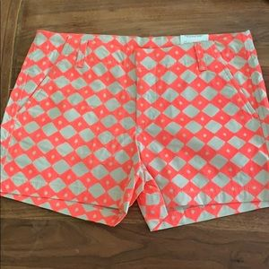 Never worn orange patterned shorts with tags.